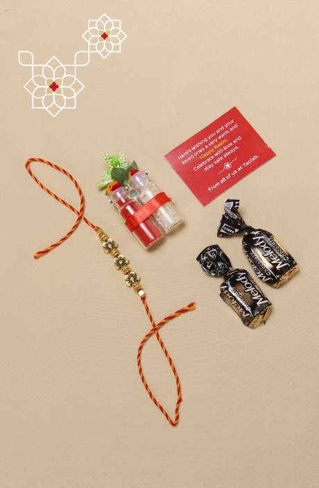 Auspicious Golden Metallic Rakhi for Brother, Teeka and Chawal with 2 Melody Toffees - B8SRA-B