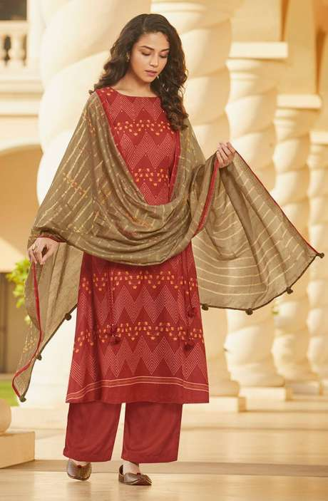 Spun Winterwear Printed Salwar Kameez In Rust with Muslin Silk Dupatta - SAG5622
